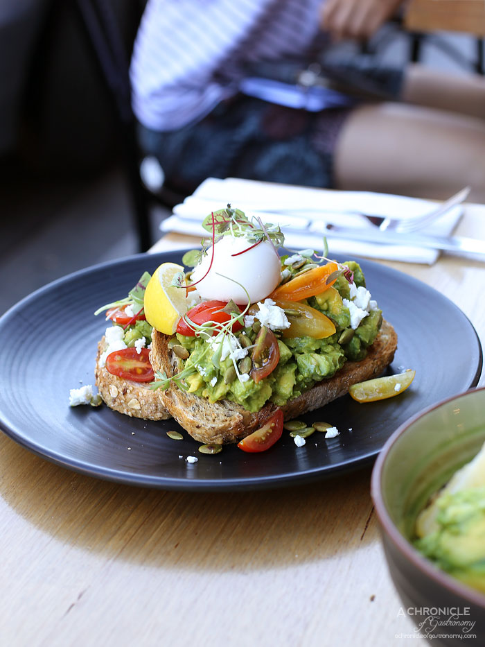 Onethirtytwo - Smashed Avocado on seeded toast w heirloom tomatoes, Greek feta, pumpkin seeds, poached egg ($16.50+2.50)