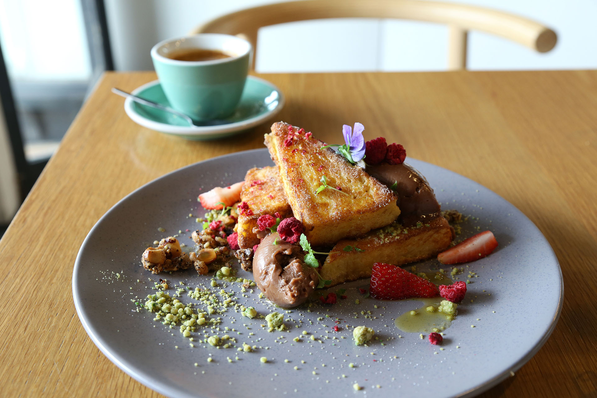 Prospect Espresso - Jaffa Brioche French Toast served w whipped Nutella mascarpone, citrus segments, orange syrup, freeze dried raspberry, matcha soil and hazelnut crumble ($18.50)