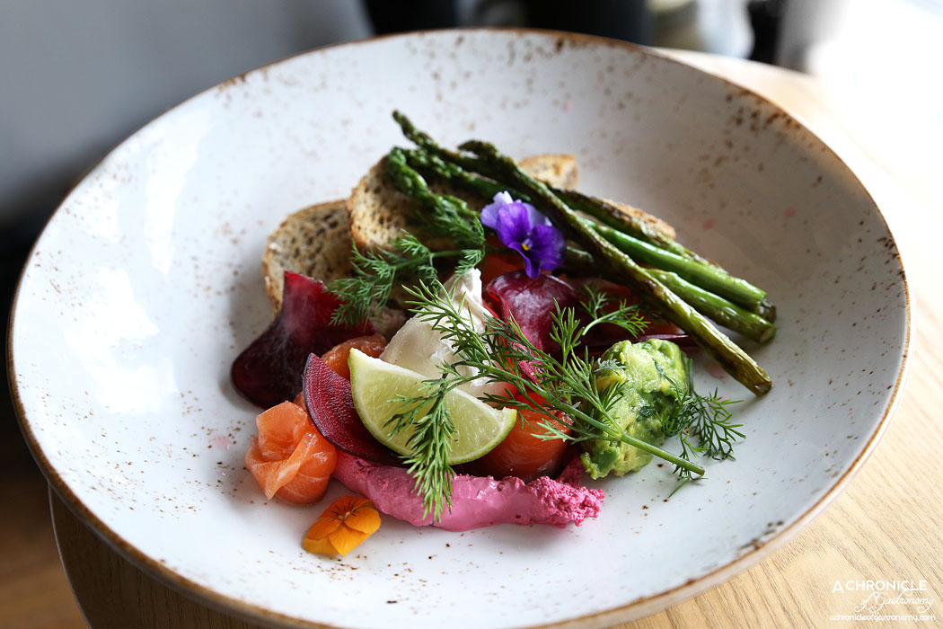 Prospect Espresso - House dill and citrus cured trout w grilled asparagus, smashed avocado, radish, poached egg, multigrain toast, beetroot goats cheese curd ($18.50)