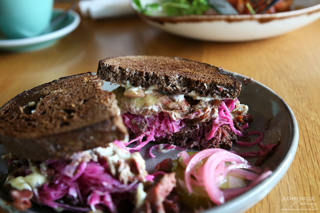 Prospect Espresso - 14 hour Smoked Beef Brisket Reuben w dark rye toast, pickles, grilled Jack cheese, dijonnaise mayonnaise, house made pickled cabbage ($18)