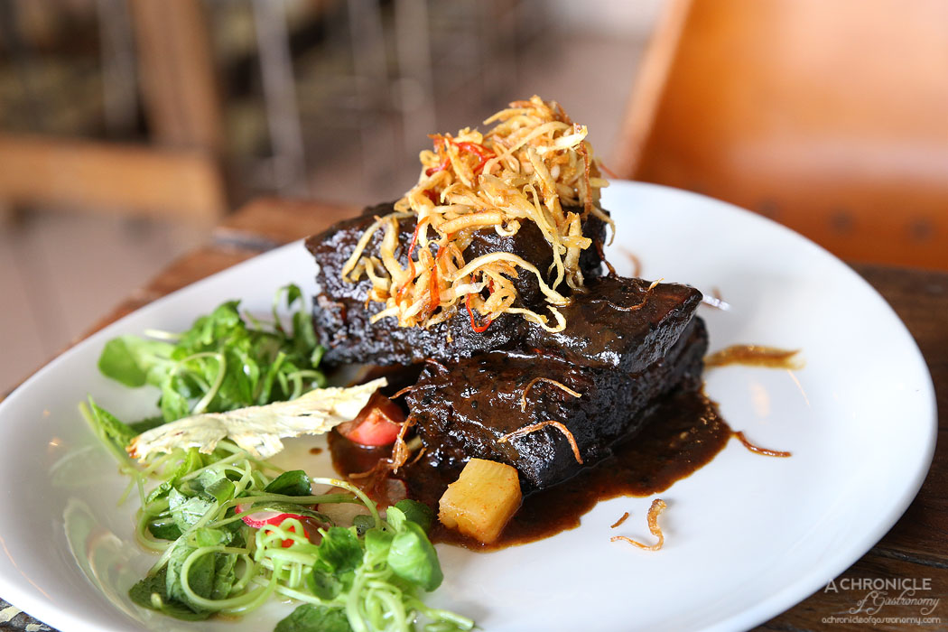 Amok - Twice cooked tender beef rib, caramelised coconut chilli, pickled pineapple, morning glory