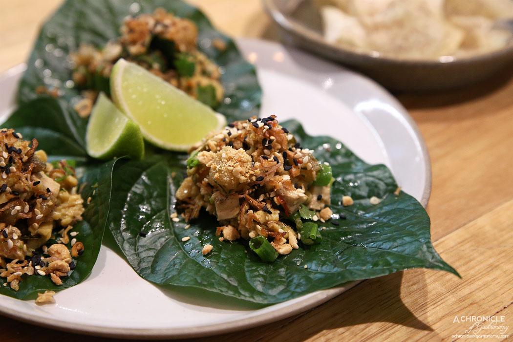 An Uong - Tofu Betel San Choi Bao w lemongrass, chilli, lime w betel leaf ($6)