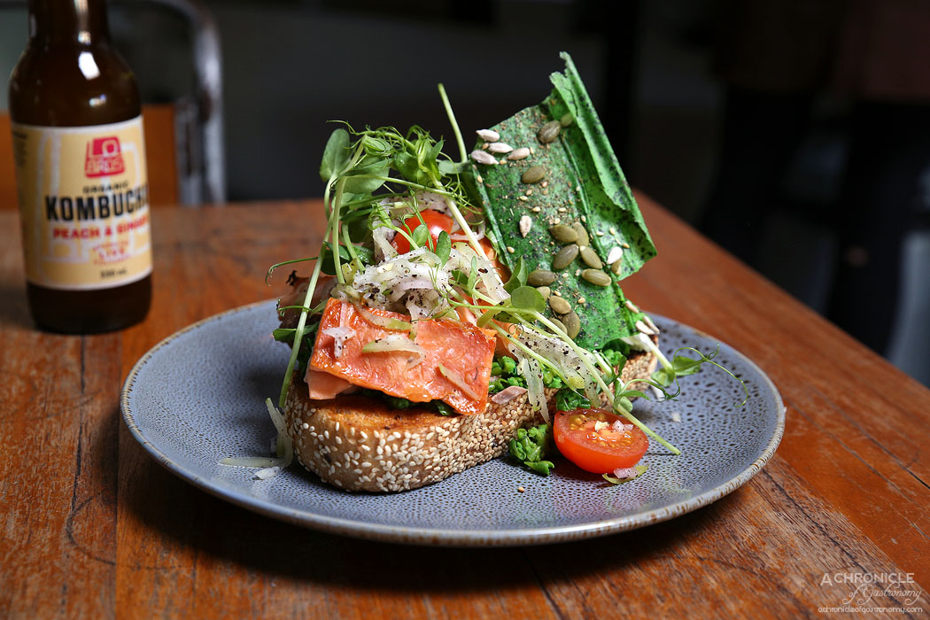El Mirage - Smashed Peas on seeded grain toast w hot smoked salmon, poached eggs and apple and fennel salad ($18.50)