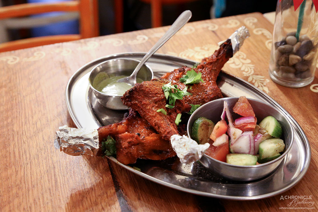 Mukka - Spicy Lamb Chops marinated in lime juice, dark spices, ginger, garlic, served with Kachumbar salad and coriander chutney ($18)