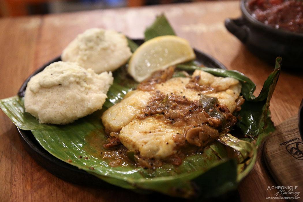 Mukka - Banana Leaf Fish Fry - Garlic, ginger, tomato, green chilli, desiccated coconut, onion, fish and idli ($16)