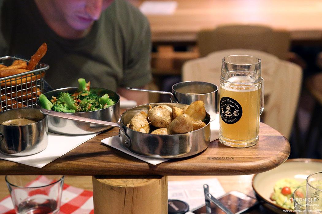 Munich Brauhaus - Broccoli w roasted garlic dressing, sweet potato fries, duck fat roasted potatoes, mushroom sauce, garlic butter