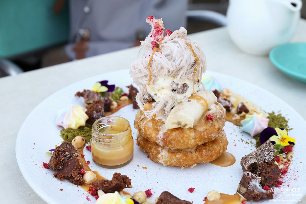 The Butler's Den (21) Roti Stack - Double stack of roti hotcake fritters w brownie, banana, strawberry, matcha soil, burnt milk, hazelnut, housemade cookies n cream ice cream, Persian chocolate fairy floss and raspberry crumble ($20)