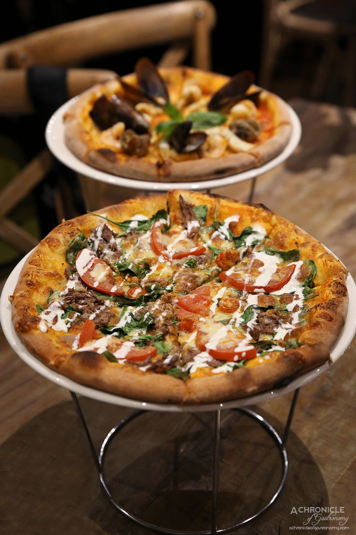 Rubicon - Pulled Beef Pizza w San Marzano tomato, mozzarella cheese, pulled beef, spinach and fresh tomatoes topped w yoghurt sauce ($23.50)