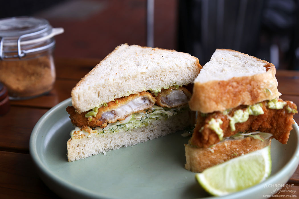 Saint James - Fish finger butty, market fish, crushed pea aioli, dill & cabbage salad on fresh white bread ($16)