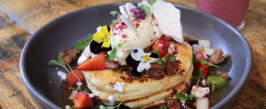 Faraday's Cage - Ricotta Pancakes - Caramelised white chocolate, broken meringue, passionfruit, maple syrup, dehydrated strawberry, lemon balm, mascarpone, berries ($17)