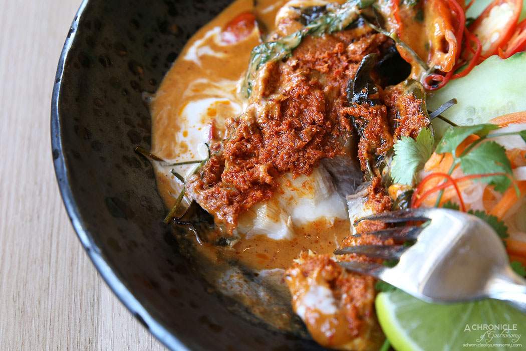 Thai Thani - Grilled Hiramasa King Fish Fillet in red curry paste wrapped in banana leaf, grilled in rich curry paste and coconut cream, flavoured with fresh kaffir lime leaves and sweet basil ($22)1