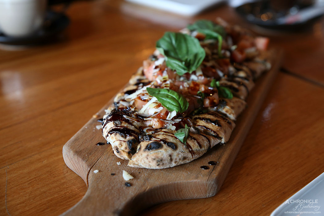 Mother Dough - Pizza Bruschetta - Diced tomato, parmigiano and basil with balsamic vinaigrette served on our homemade foccacia Mother Dough style ($14)