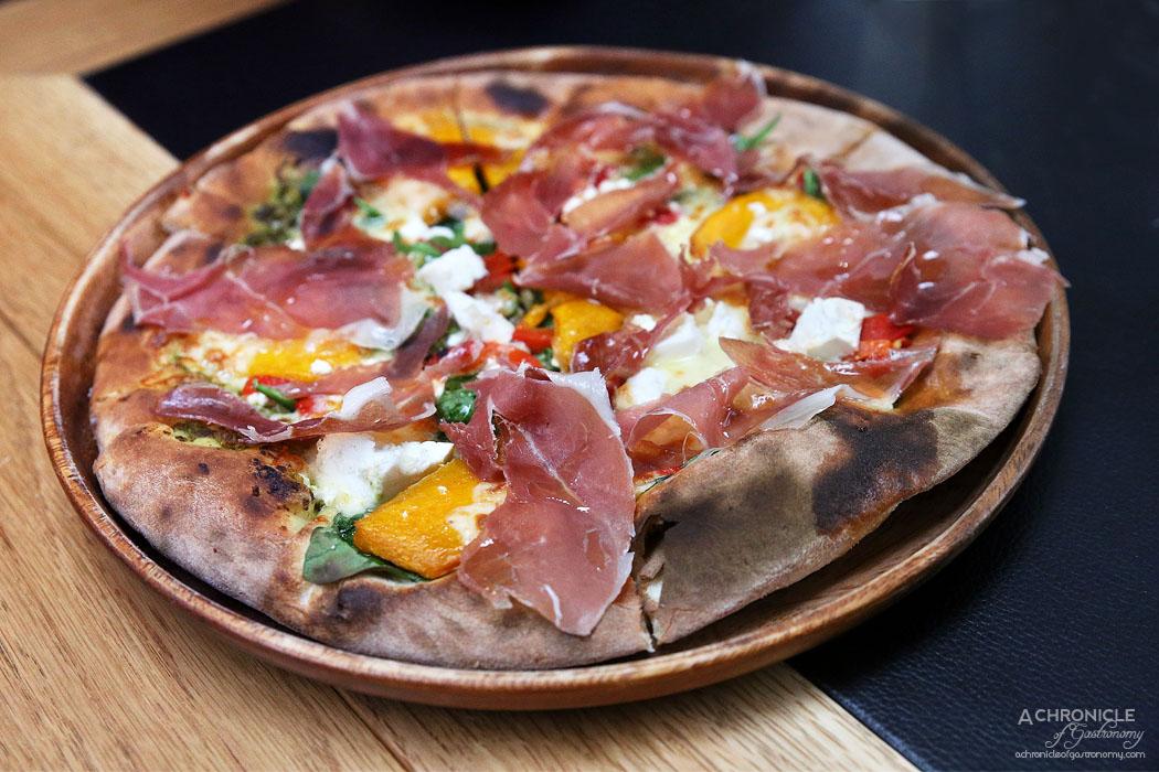Piccolino - Prosciutto Pizza - Pesto base, mozzarella, baby spinach, prosciutto, roasted pumpkin, roasted pepper, fetta ($25)