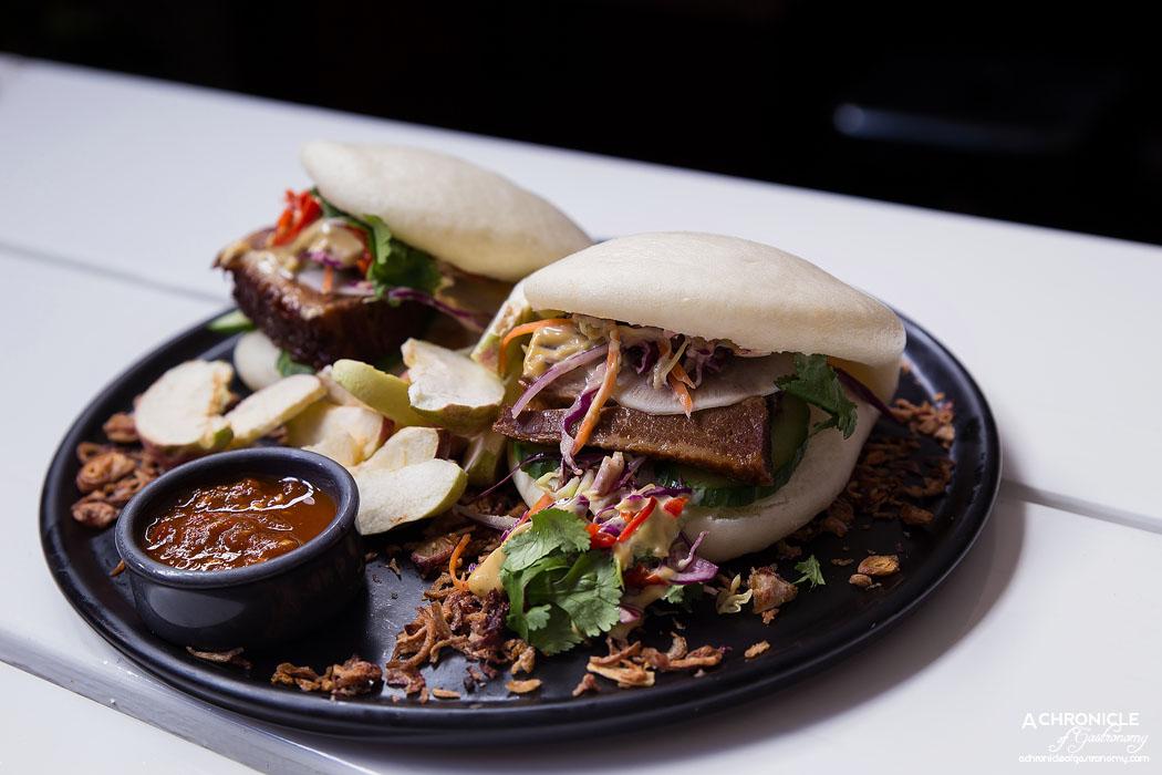 Pillar of Salt - Steamed bao bun sliders - Dongpo slow-brased pork belly, Asian slaw, pickled daikon radish, hoi sin aioli, fried shallots, apple chips, pillar hot sauce ($24)