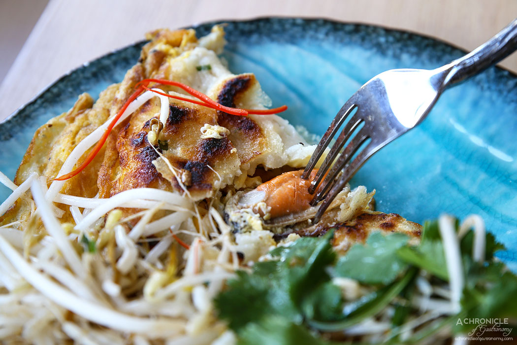 Thai Thani - Crispy Mussel Pancake (Hoi Tod) with wok tossed bean sprouts and sriracha sauce ($16)