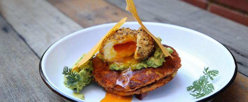 Be The Duck - Truffled Sweet Potato and Corn Fritters - Dukkah coated son in law egg, smashed avo, bacon, corn tuille ($19)