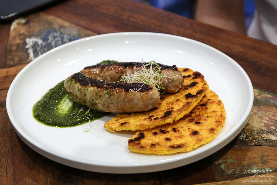 Buenos Dias - Chorizo Gaucho (Argentina) Two house made Argentinean chorizos on arepa served with house made chimichurri ($18)