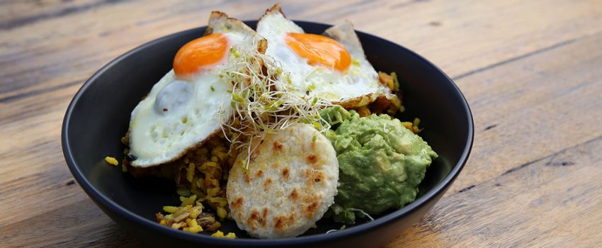 Buenos Dias - Calentao Rolo (Colombia) - Colombia rice mix with house made chorizo, pulled pork and beans topped w fried eggs, arepa and avocado