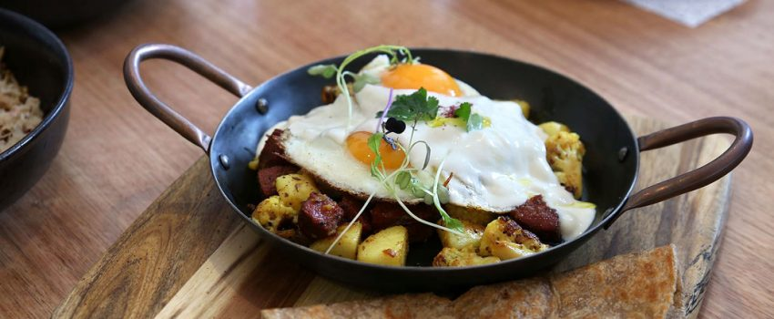 Proud Sprout - The Rikshawala - Cumin cauliflower, sujuk, potatoes, fried eggs, chilli and yoghurt served w roti paratha ($18)