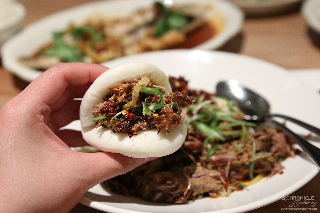 Ricky and Pinky - Shredded cumin lamb, crispy chilli, cucumber pickle and steamed bao