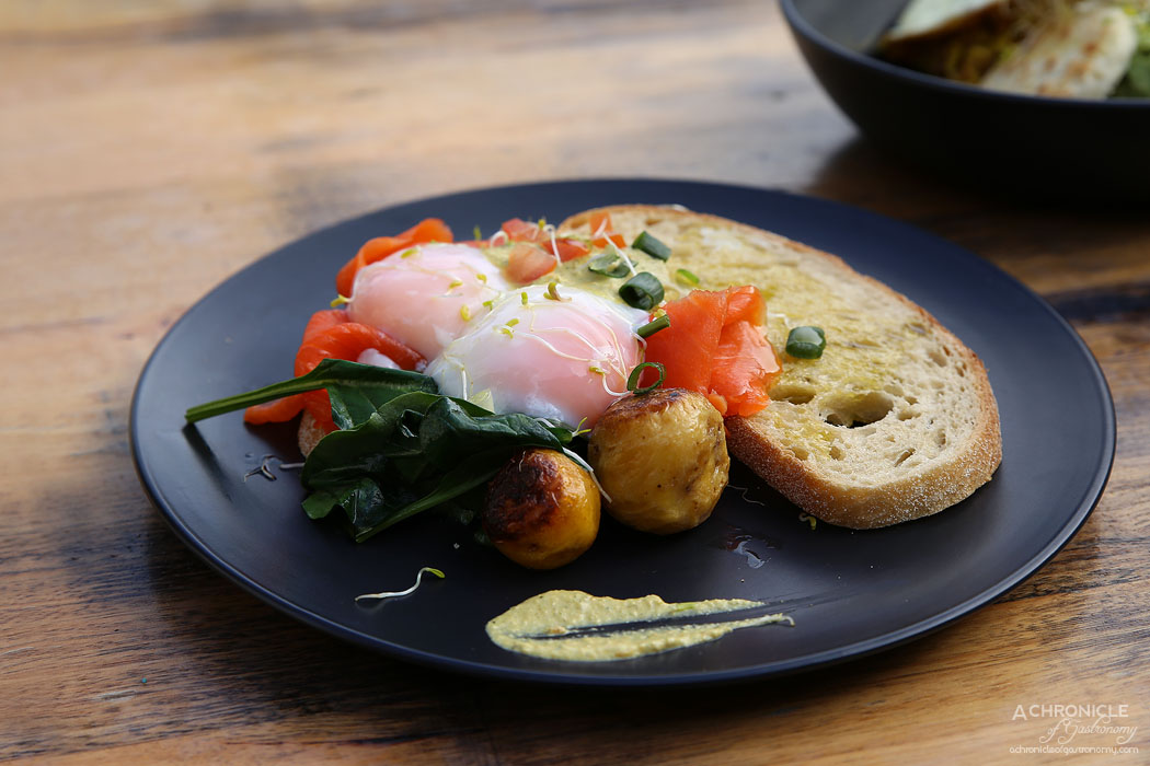 Buenos Dias - Royal Inca Eggs - Slow-cooked, sous vide style eggs on toasted organic sourdough, smoked salmon and spinach, house made creamy, lightly spiced Tari-Tari sauce made w Peruvian Aji Amarillo peppers