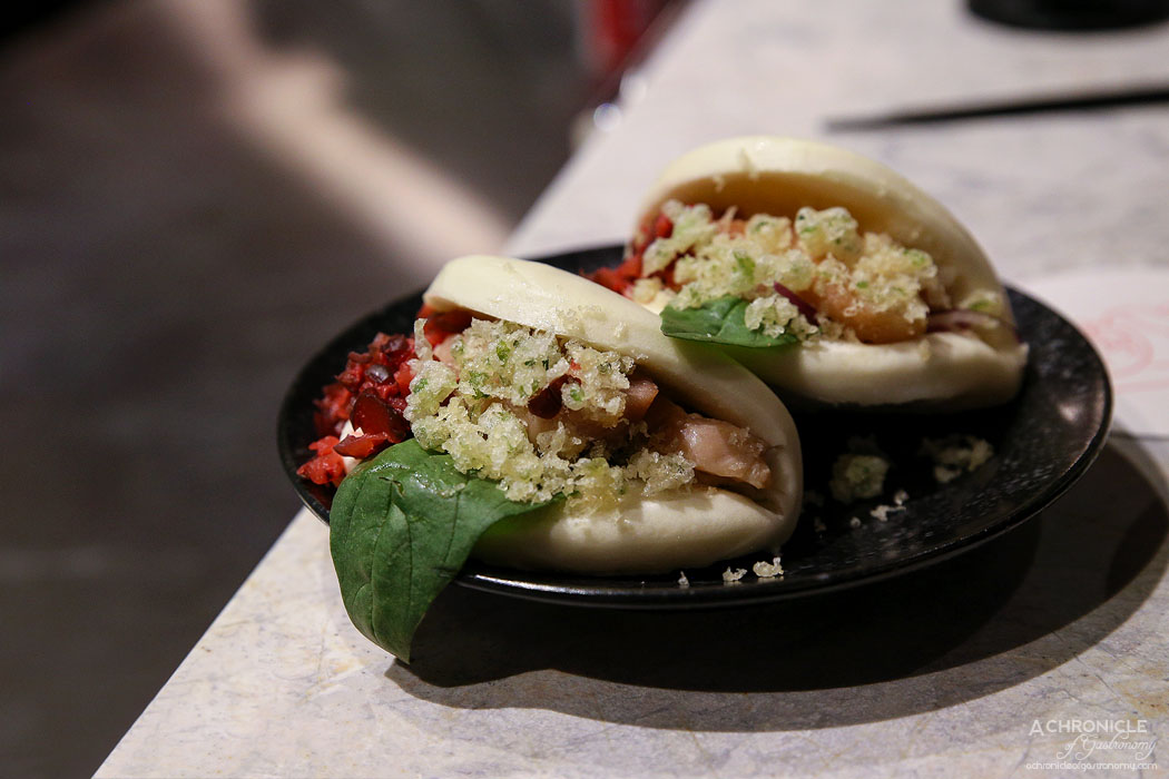 The Modern Eatery - Bao Bae - Grilled chicken bao with aonori bits, red pickle, condiments ($14)