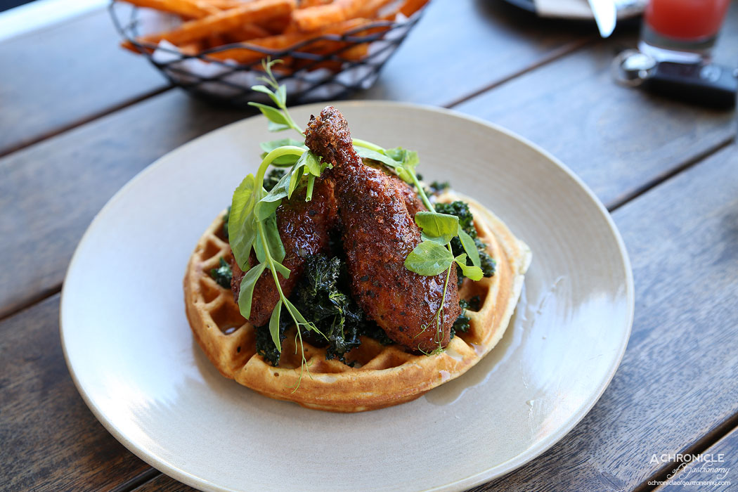 The Train Yard - Fried chicken and waffle with sauteed kale chips and maple syrup ($19.50)