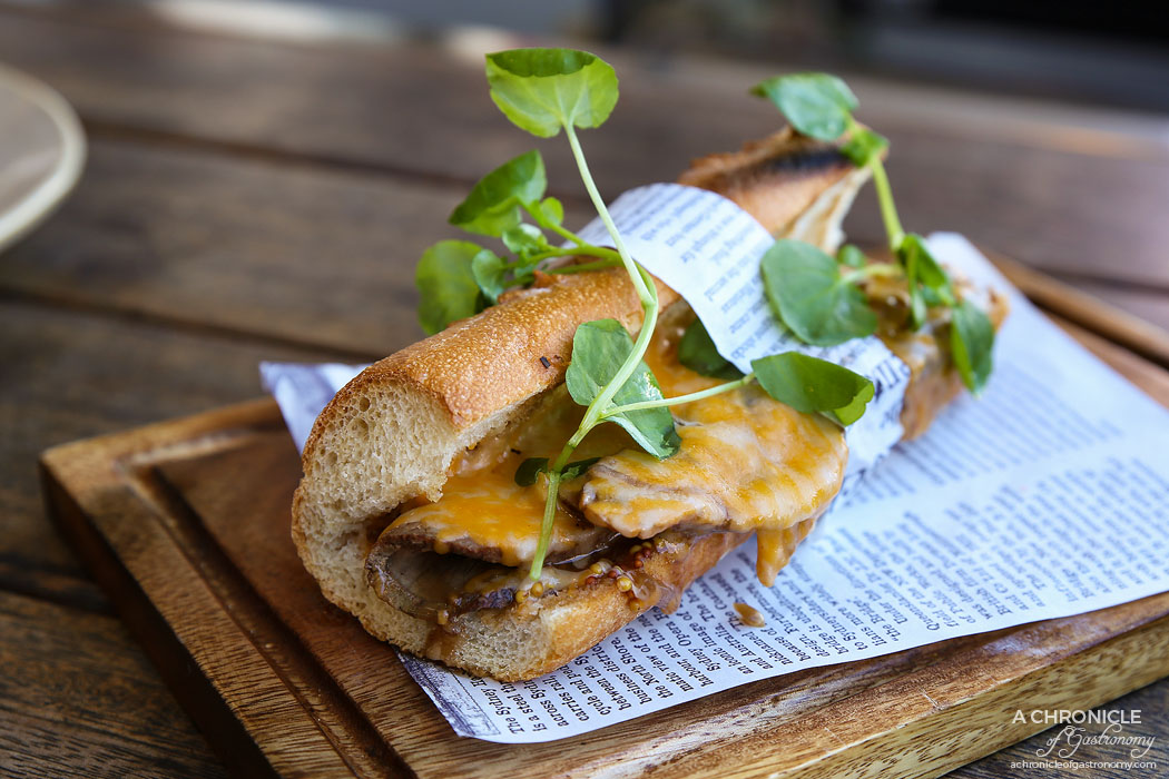 The Train Yard - Tri-tip beef baguette with seeded mustard and mushroom and onion stew, Monterey Jack and Asadero cheese melt ($16)