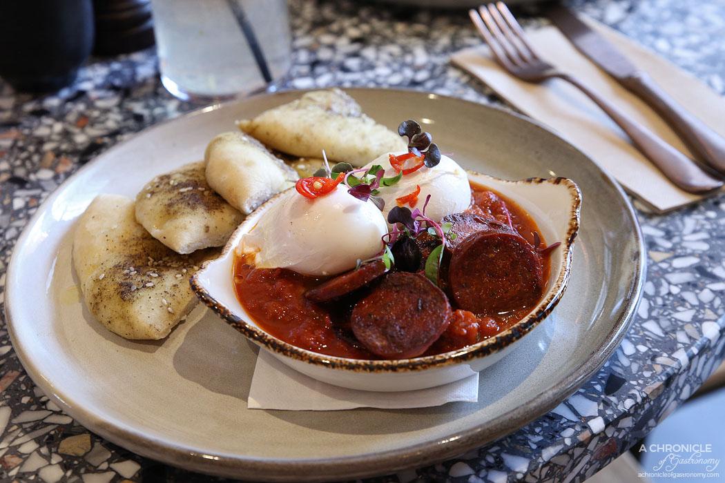 Middle South East - Middle South Eggs - Middle Eastern bake, Persian feta, fresh chilli, sujuk, chunky bread and poached egg ($18)