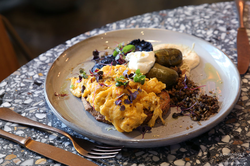 Middle South East - Homage to Teta - Cumin scrambled eggs, filled zucchini, labne, mujadara and baked mushroom on chunky organic sourdough ($18)
