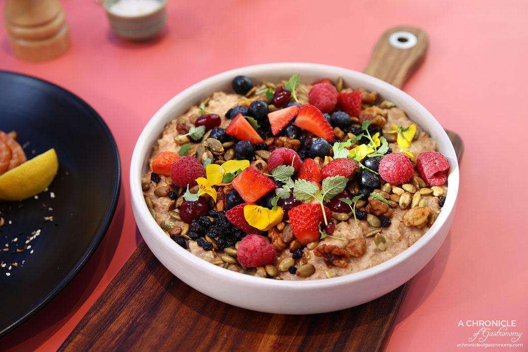 Au79 - Cinnamon & Nutmeg Porridge - With macerated currants, candied walnuts, fresh berries, lemon balm, pomegranate and vanilla honey yogurt ($16)