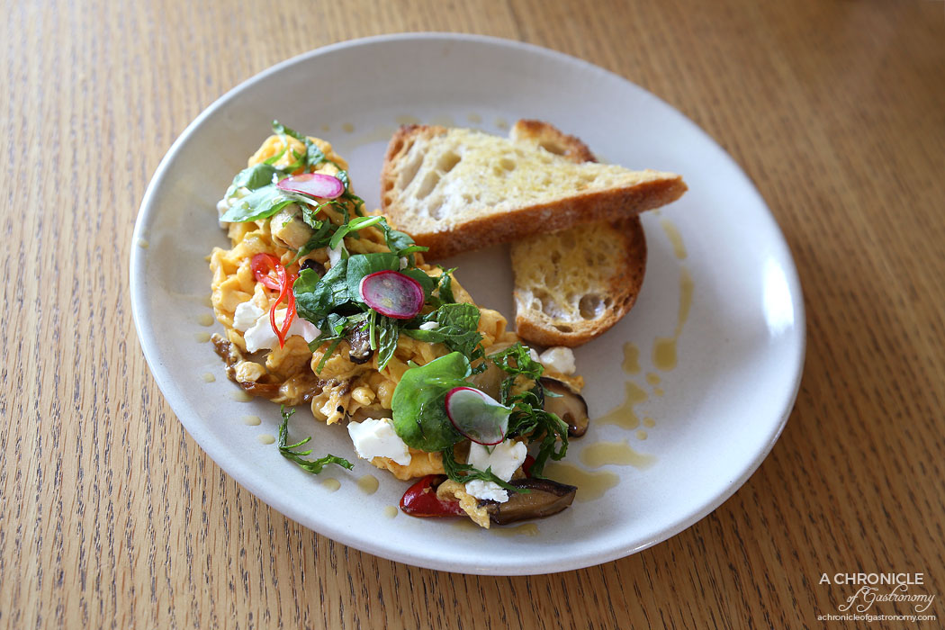 Mary Miller - Chilli Scrambled Eggs - Fried chilli and scrambled egg on toast, shiitake mushrooms, basil and chilli infused olive oil, crispy shallots goats cheese and fresh mint ($18)