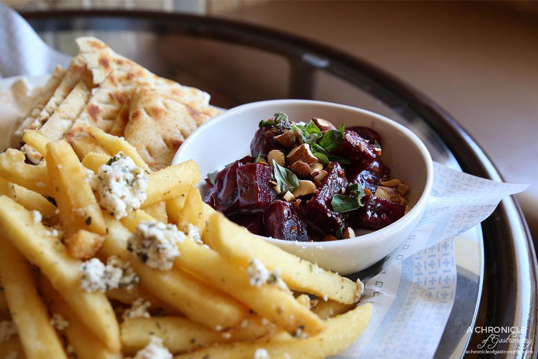 Jimmy Grants - Eat Like a Greek - 300g lamb and chicken combo, beet salad (roast beetroot, lemon, tahini yoghurt, smoked almonds), side chips w feta, garlic oil, oregano, taramasalata, pita ($39.90)