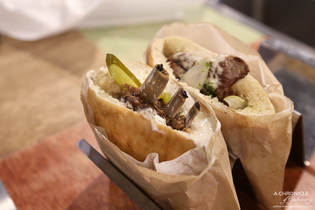 Miznon - Pita with a bone - Lamb rib stew, tahini, pickles, onion, chilli ($19)