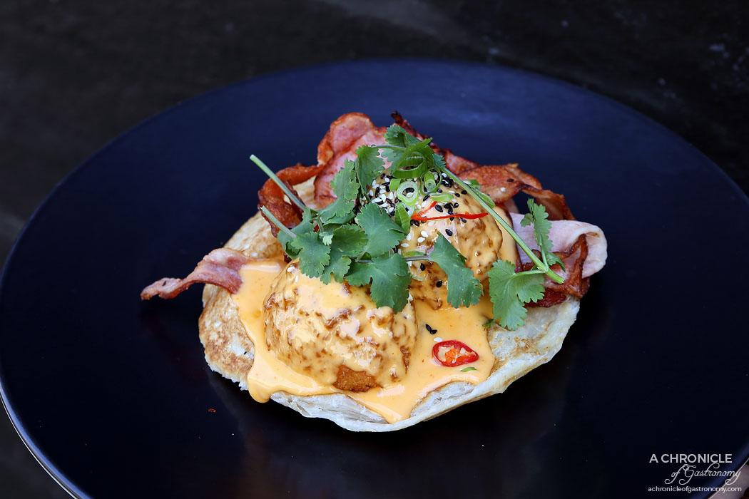 Sir Charles - Sir Charles Benedict - Panko crumbed eggs w sriracha hollandaise, bacon and fresh chilli on roti ($19)