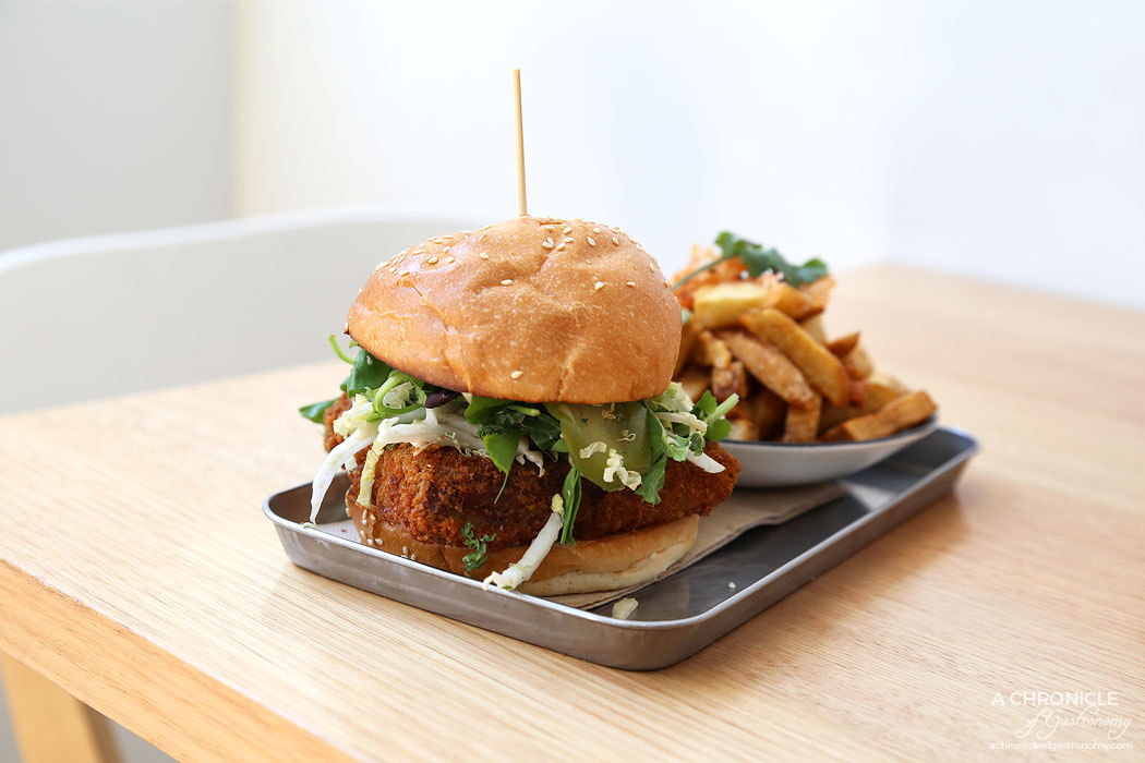 Sir Charles - Pork Burger - Pulled pork and mozzarella croquette w apple and pickled fennel slaw, BBQ sauce and apple cider mayo on toasted brioche bun, kimchi fries ($18.90)