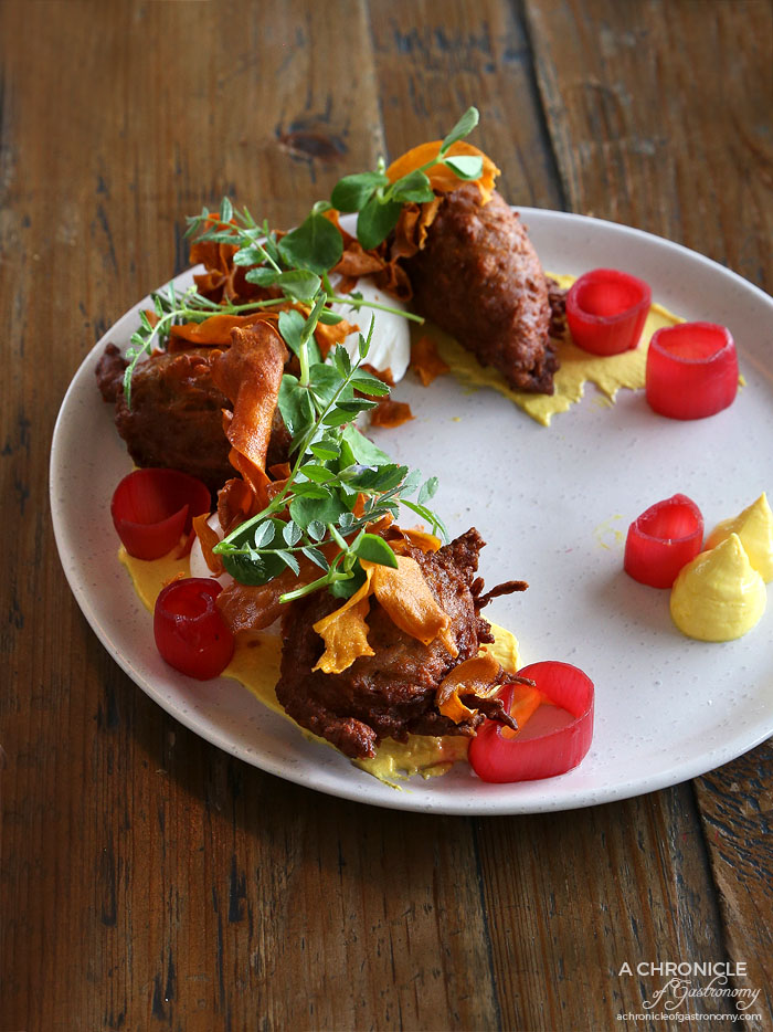 Addict - Sweet Potato Fritters - Spiced hung yoghurt, fresh herbs, pickled shallots, crispy sweet potato and poached eggs ($18)