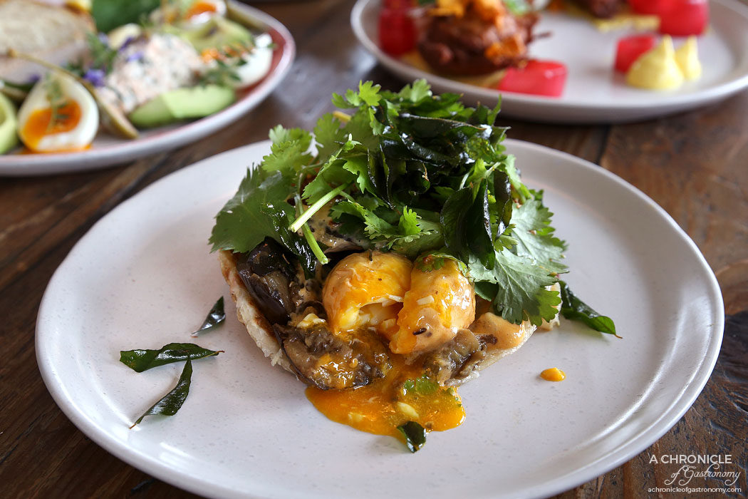Addict - Son In Law Eggs Benedict - Smoked eggplant, tom yum hollandaise, fried onion, coriander, curry leaf and roti ($18)