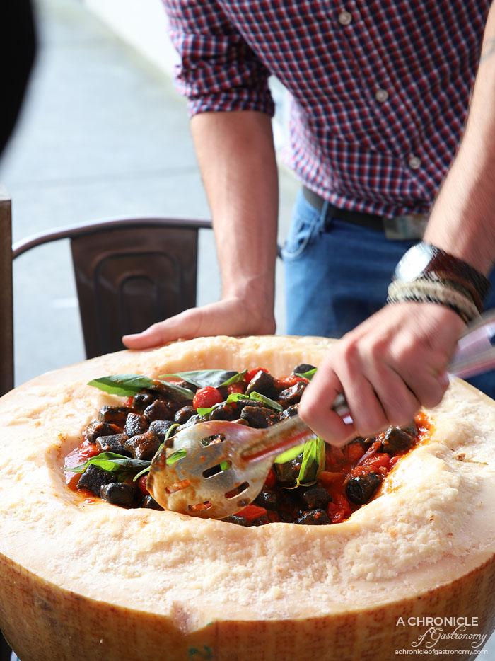 48h Pizza & Gnocchi Bar - Carbone Vegetale Parmigiano Gnocchi - Sicilian cherry tomato sauce, parmesan raschiatura peeled datterini, served in a wheel of parmigiano ($24.50 pp)