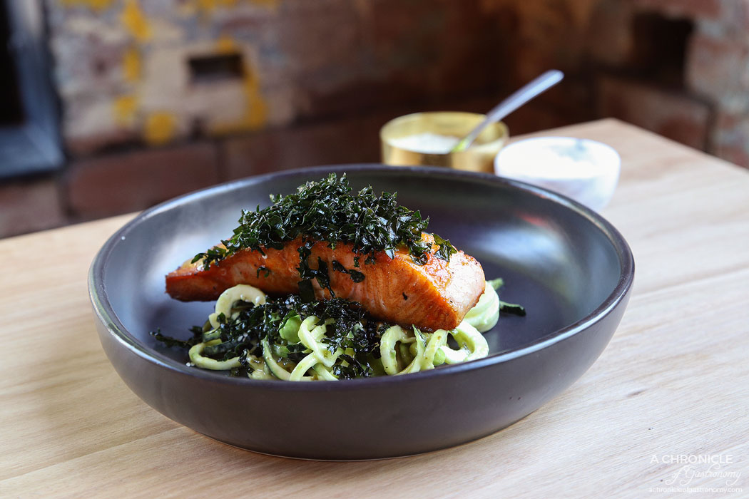 Bentwood - Grilled Salmon w raw zucchini zoodles, edamame, avocado, sriracha, sesame, fried cavolo nero and herb dressing ($22)