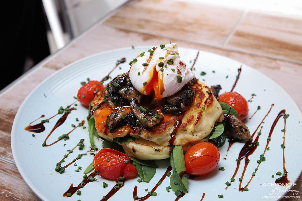 Chicken or the Egg - Mushroom Hotcakes - Mushroom and ricotta hotcakes, sauteed mushrooms, spinach, cherry tomato, poached egg ($19.80)