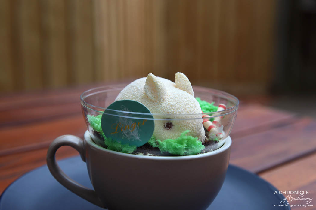 Linger Patisserie - Bunny - White chocolate parfait and white chocolate coating, passionfruit jelly, matcha panna cotta ($15)