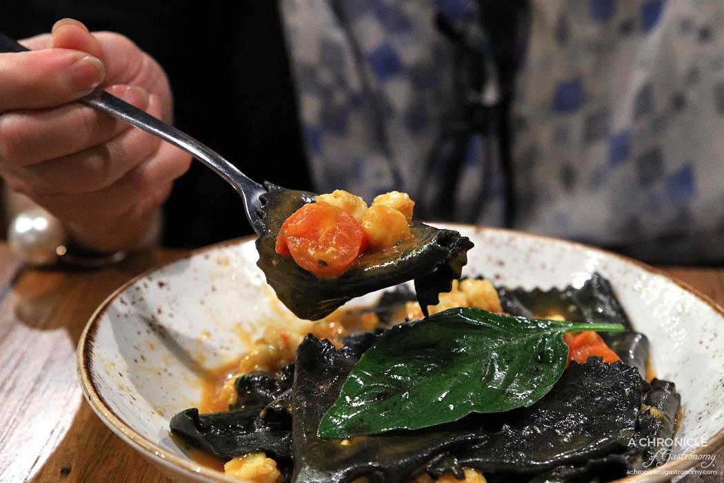 Basta - Maltagliati Al Nero - House-made squid ink maltagliati, king prawns, saffron and tomato consomme ($29)