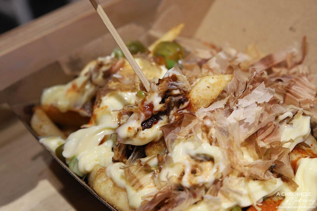 Kung Fu Burger - Bruce Chips - Pulled Pork, Sriracha Mayo, Jalapeno, Spring Onion, Bonito Flakes ($8,50)