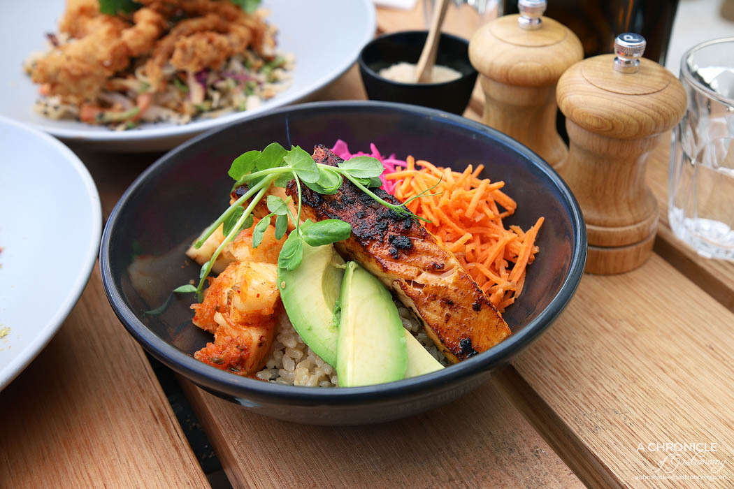 Stanley - Sriracha Salmon Flora Bowl w brown rice, pineapple, kimchi, pickled red cabbage, edamame, shredded carrot, avocado with miso dressing ($19.50)