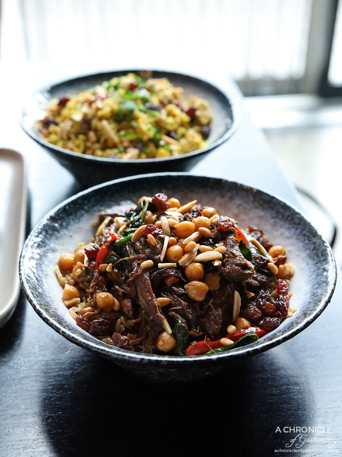 Mama Rumaan - Qouzi - Slow cooked lamb shoulder, pomegranate, traditional herbs and spices, wheat and chickpeas (small, $19)