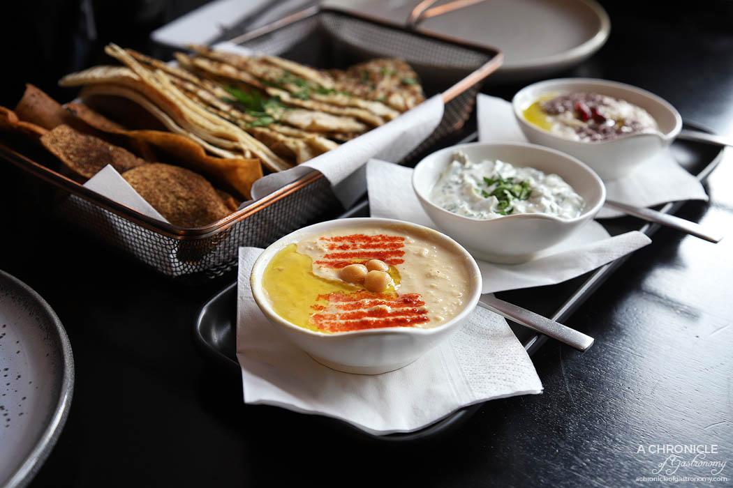 Mama Rumaan - Mezze Dips - Hummus, baba ghanoush, jajik, fried pita with zaatar and flatbread ($15)