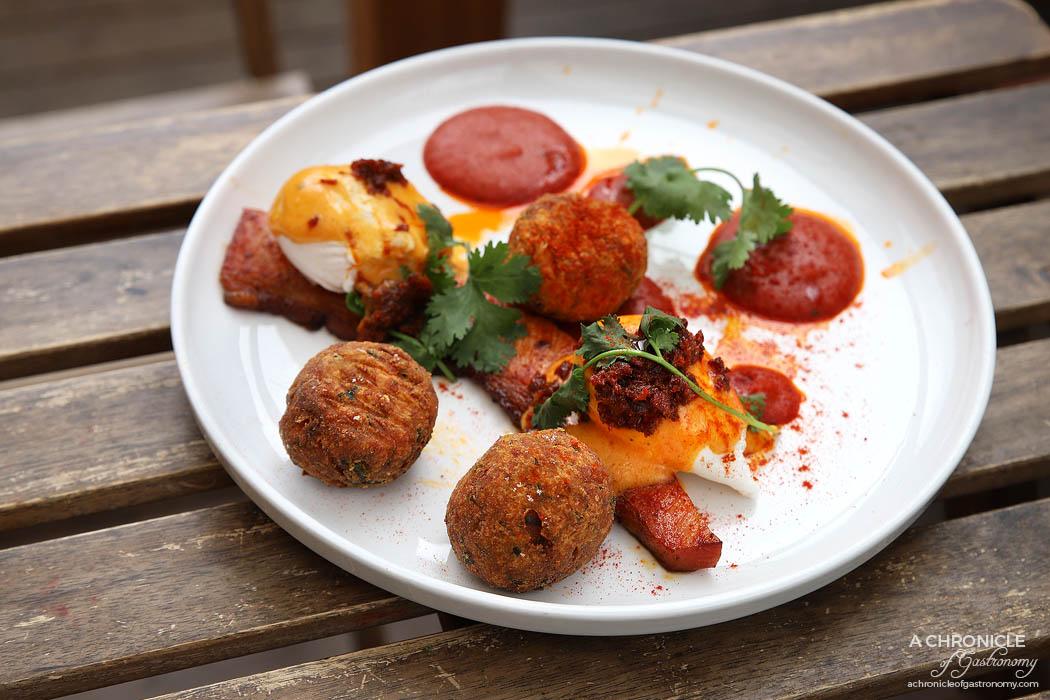 Dish and Spoon - Dish & Spoon Bomba - Bomba with hand cut berkshire bacon, Kurobuta chorizo crumb, poached eggs, tomato & tarragon hollandaise with spiced pepper puree ($19.50)