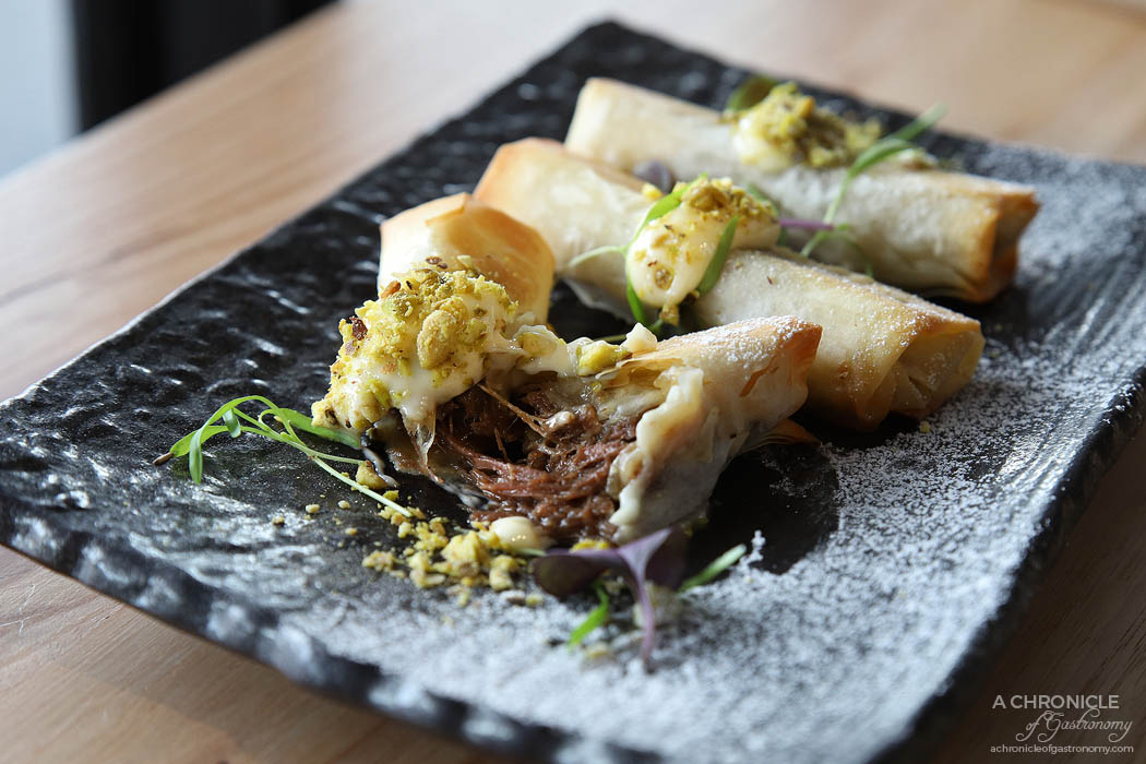 Tora - Braised beef cigars, yuzu mayo, snow sugar, pistachio (3 for $12)
