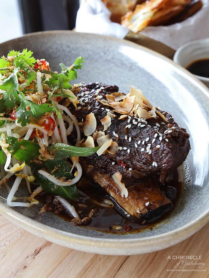 Tora - Chilli Caramel Beef Ribs - Thai shoot salad, nuoc mam dressing, toasted coconut ($23)